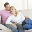 Couple relaxing in living room and smiling — Stock Photo #4763853