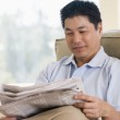 Man relaxing with a newspaper — Stock Photo #4763882