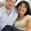 Couple relaxing in living room and smiling — Stock Photo #4763898