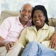 Couple relaxing in living room and smiling — Photo