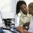 Couple in home office using computer — Stock Photo