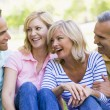 Two couples outdoors smiling — Stock Photo