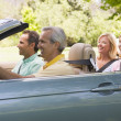 Two couples in convertible car smiling — Foto Stock