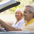 Couple in convertible car smiling — Stock Photo #4764137