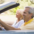 Couple in convertible car smiling — Stock Photo #4764139