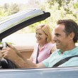 Couple in convertible car smiling — Stock Photo #4764165