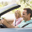 Stock Photo: Couple in convertible car smiling