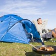 Man camping outdoors and cooking — Stock Photo #4764203