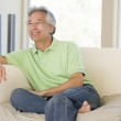 Man sitting in living room smiling — Stock Photo #4764430