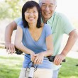 Mature couple bike riding. — Foto de Stock