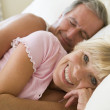 Couple lying in bed together smiling — Stock Photo #4764917