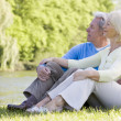 Couple outdoors at park by lake — Stock Photo