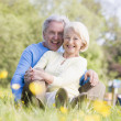 Stock Photo: Couple relaxing outdoors smiling