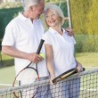 Couple playing tennis and smiling — Stock Photo #4765040