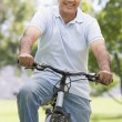 Man on bike outdoors smiling — Stock Photo