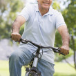 Man on bike outdoors smiling — Stock Photo #4765061