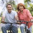 Mature couple bike riding. — Stock Photo