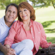 Couple at a picnic holding hands and smiling — Stock Photo