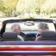 Couple in convertible car smiling — Stock Photo #4765081