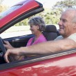 Couple in convertible car smiling — Stock Photo #4765082