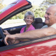 Couple in convertible car smiling — Stock Photo #4765083