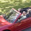 Couple in convertible car smiling — Stock Photo #4765089
