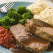 Mama&#039;s Meatloaf with Mashed Potato Broccoli Tomatoes and Gravy - Stock Photo