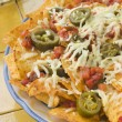 Platter of Nachos with Salsa Jalapenos and Cheese — Stok fotoğraf
