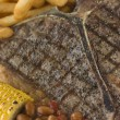 T-Bone Steak with Fries Corn and Beans — Stock Photo