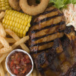 Stock Photo: Barbeque Chicken and Ribs with Fries Slaw and Salsa
