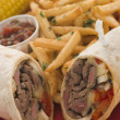 Philly Beef Steak Wrap with Fries Tomato Salsa and Corn — Stock Photo #4765226