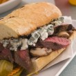 Steak and Roquefort Sandwich with Fries Gherkins and Chillies — Stock Photo #4765228