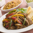 Steak Fajitas with Jambalaya Guacamole Salsa and Sour Cream - Stock Photo