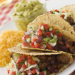 Beef Tacos with Cheese Salad and Guacamole - Stock Photo