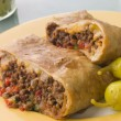 Chimichanga with Pickled Chillies and Guacamole - Stock Photo