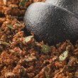 Cajun Spice Rub in a Pestle and Mortar - Stock Photo