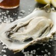 Opened Rock Oyster with Hot Chilli Sauce Lemon and Sea Salt — Stock Photo