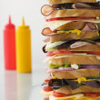 Dagwood Tower Sandwich With Sauces - Stock Photo
