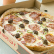 Meat Feast Pizza in a Take Away Box - Foto de Stock
