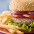 Beef Burger in a Sesame Seed Bun with Fries — Stockfoto