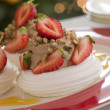 Stock Photo: Meringue Nests filled with a Sweet Chestnut Cream and Strawberri