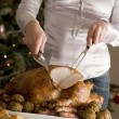 Stock Photo: Carving Christmas Roast Turkey with all Trimmings