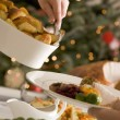Serving Roast Potatoes at Christmas Lunch — Stock Photo #4765439