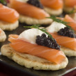 Smoked Salmon Blinis Canap s with Sour Cream and Caviar - Stock Photo