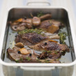Stock Photo: Tray of Confit Duck Legs