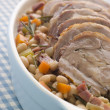 Braised Boneless Shoulder of Lamb with Beans - Stock Photo