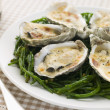 Stock Photo: Grilled Oysters with Mornay Sauce on Samphire