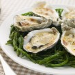 Grilled Oysters with Mornay Sauce on Samphire — Stock Photo
