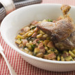 Confit Duck Leg with Flageolet Beans and Bacon - Stock Photo