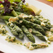 Asparagus Spears with Polonaise Vinaigrette and Salad Leaves - Stock Photo